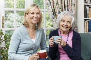 image of two women drinking a cup of tea